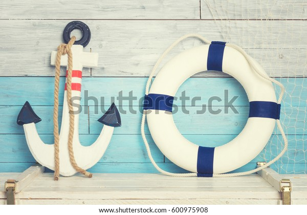 Anchor and lifeline against the background of blue-white boards