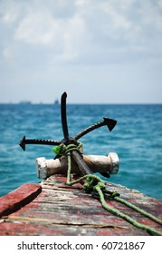 Anchor on the bow of an old Dhow at sea