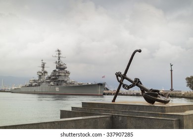 "Anchor on the embankment and the cruiser ""Mikhail Kutuzov""  in the port of Novorossiysk, Russia"