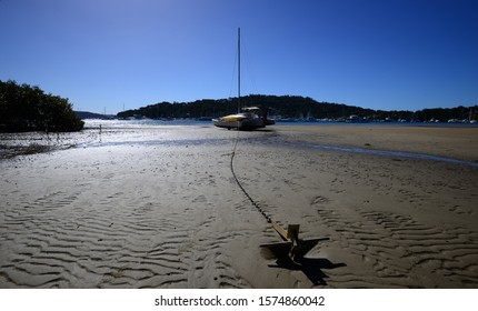 Anchor seating on sand at low tide - Sydney