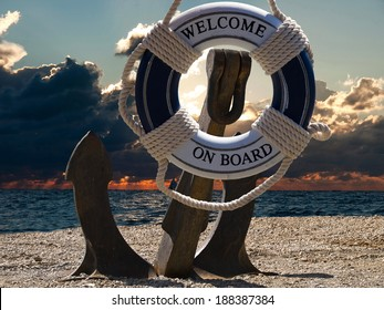 anchor in sunset with the boats on a sea and safe belt with welcome sign