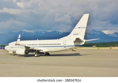 ANCHORAGE, AK -22 MAY 2015- An unmarked private Boeing 737 airplane (registration N959BP) is getting ready for takeoff at the Ted Stevens Anchorage International Airport (ANC) in Alaska.