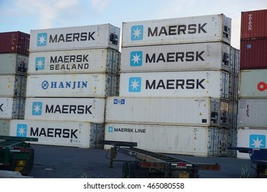 ANCHORAGE, AK -25 JUNE 2016- Shipping freight containers are piled up on a pier in the Port of Anchorage in Alaska.