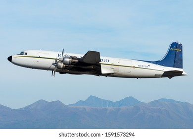 Anchorage, AK / USA - September 11 2018: Everts Air Cargo Douglas DC-6 N747CE departure from Anchorage Airport. Old four engines piston aircraft capable of flying in gravel runways around Alaska.