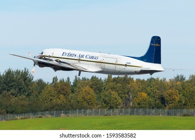 Anchorage, AK / USA - September 12 2018: Everts Air Cargo Douglas DD-6 registered as N151 flying revenue. Classic aircraft flying in Alaska with trees for background. Airplane delivered in 1956.
