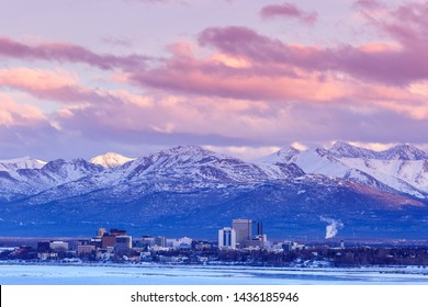 Anchorage, Alaska, United States. January 25, 2014.  Anchorage Alaska skyline in winter at dusk with the Chugach mountains behind.