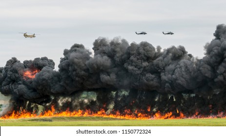 ANCHORAGE, ALASKA / USA - June 30, 2018: A United States Army UH-60 Blackhawk Helicopter, and other helicopters, perform a 'show of force' demo at the 2018 Arctic Thunder Airshow.