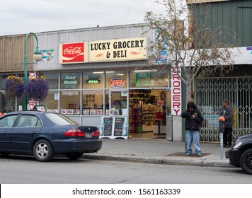 Anchorage, Alaska/United States – 08/31/2019: A view of the storefront of Lucky Grocery and Deli, a local convenience store in downtown Anchorage that also serves deli style food.