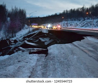 ANCHORAGE, ALASKA/USA – Nov. 30, 2018: Police block traffic on the southbound Glenn Highway north of Anchorage, Alaska, due to damage from a magnitude 7.0 earthquake.