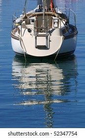 Anchored boat with a reflection