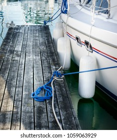 Anchored boat and wooden pier, Toronto, Canada