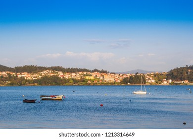 Anchored boats in front off Campelo village of Poio town in Pontevedra estuary