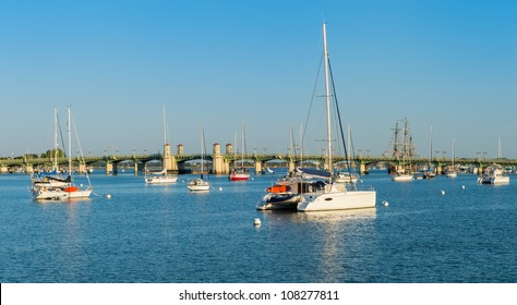 Anchored boats in the Matanzas river in St. Augustine, Florida. View of the Bridge of Lions in the background