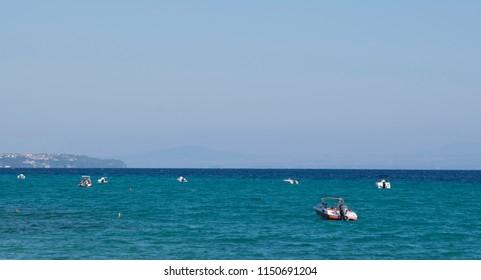 anchored boats at sea