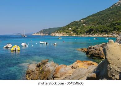 Anchored boats in waters of Tyrrhenian Sea, Sant Andreas on Elba Island, Italy