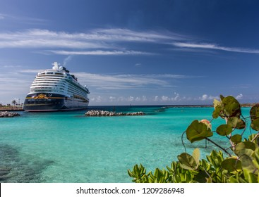 Anchored Disney Cruise Line ship called Dream picture taken from its far back on Castaway cay, Bahamas with beautiful aqua color Caribbean waters and deep blue sky and white clouds on November 7 2016.