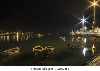 Anchored fishing boats on Xufre harbor in Arousa Island at night