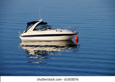 Anchored motor boat