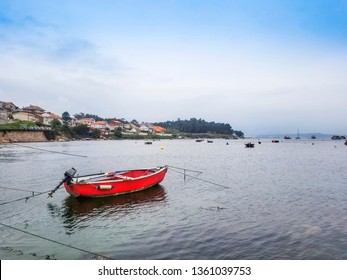 Anchored red boat on Naval fishing harbor in Arousa Island