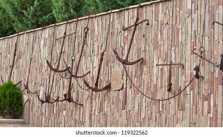 Anchors on a Brick Wall