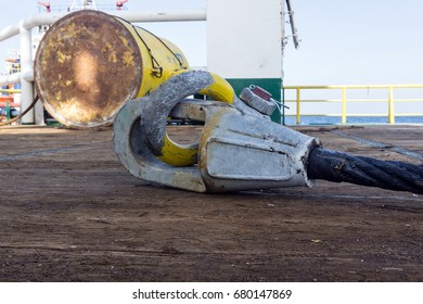 Anchor's wire rope with spelter socket attached to shackle on deck of construction barge at oil field