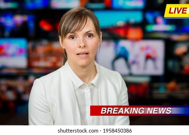 An anchorwoman reporting live breaking news sitting in Tv studio. Background of multiple screens of broadcast control room. Journalism concept