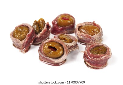 anchovy fillets stuffed with olives and pepper isolated over white background