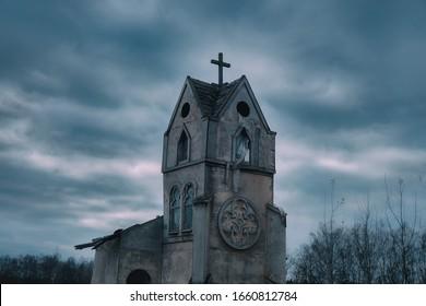 Ancient abandoned Church against a dark sky. Cityscape on Halloween, copy space