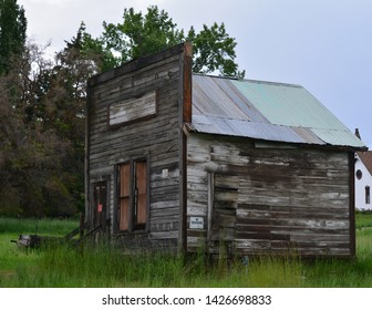 Ancient Abandoned Store on Road