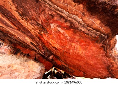 Ancient aboriginal painting art on huge rock stone in Kakadu park, northern territory, Australia.
