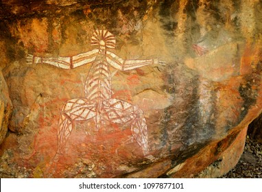 Ancient aboriginal painting of man art on huge rock stone in Kakadu park, northern territory, Australia.