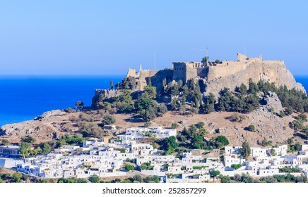 The ancient Acropolis of Lindos and the modern city. Rhodes Island. Greece