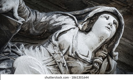 Ancient aged sculpture of beautiful Venetian Renaissance Era woman angel at Basilica di Santa Maria della Salute in Venice, Italy