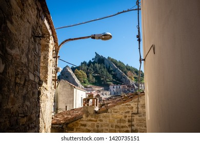 Ancient alley in Pietrapertosa village. In the background, Dolomites of Basilicata mountains called Dolomiti Lucane.  Basilicata region, Italy