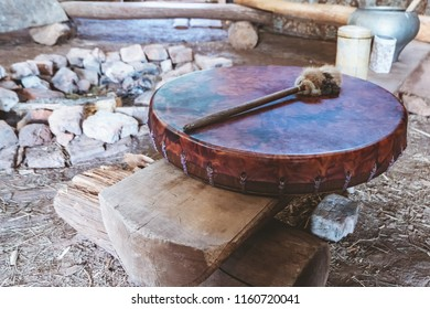 Ancient amerindian tambourine and drum drumstick. Place of the ritual
