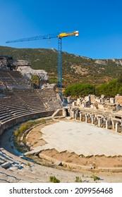 Ancient amphitheater and construction crane in Ephesus Turkey