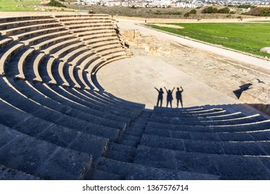 Ancient amphitheater with visitors shadow at Paphos Archaeological Park, South Cyprus