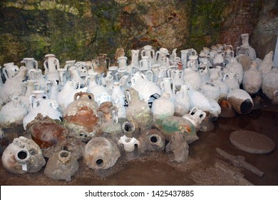 Ancient amphorae vessels in the cellar underneath amphitheater in Pula