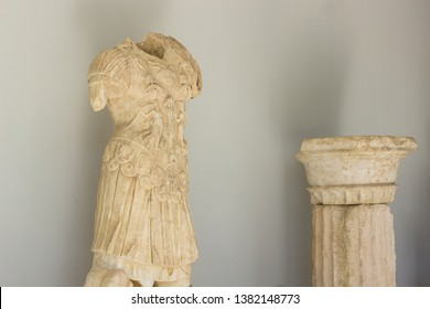 ancient antique marble architecture bust and column, indoor museum exhibit objects on white wall background with shadows