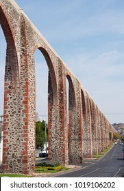ancient aqueduct of arcos on a street in Queretaro, Mexico