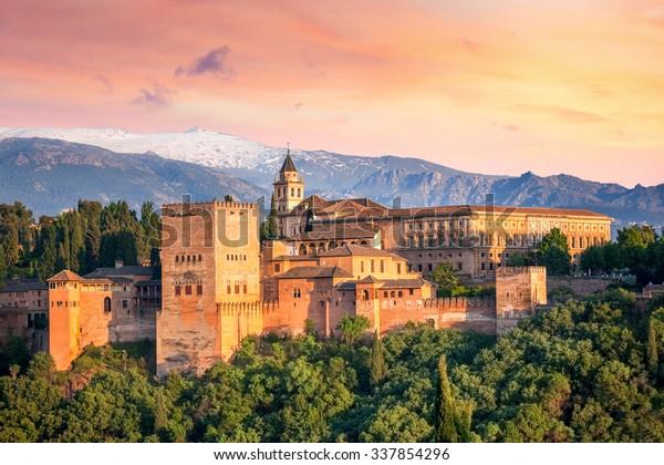 Ancient arabic fortress Alhambra at the beautiful evening time, Granada, Spain, European travel landmark