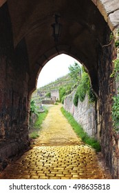 ancient arch with yellow brick road