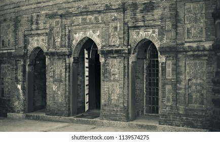 An ancient architectural building with three doors isolated unique photo