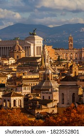 Ancient architecture in Rome. View of the city historic center old buildings with golden sunset light and red autumn leaves