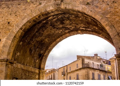 An ancient archway made for transport to go under and pass over also.