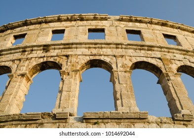 Ancient arcs of Roman empire colosseum in Pula, Croatia
