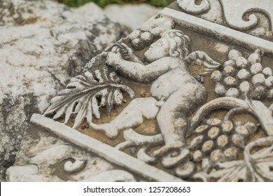 Ancient art. Details of beautiful decor of very old monument of history. Horizontal color photography.