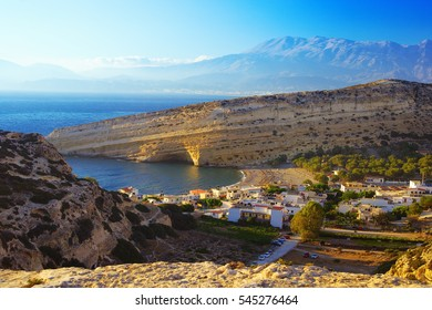 Ancient artificial cave - tomb in the town of Matala. Matala Beach - a popular tourist attraction on island of Crete. Libyan sea.