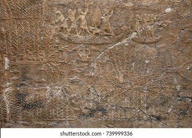 Ancient Assyrian stone carving with scripting. Campaigning in southern Iraq, Assyrian, about 640-620 BC from Nineveh