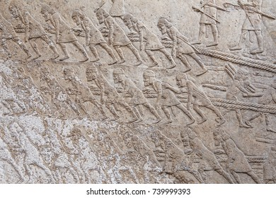 Ancient Assyrian stone carving with scripting